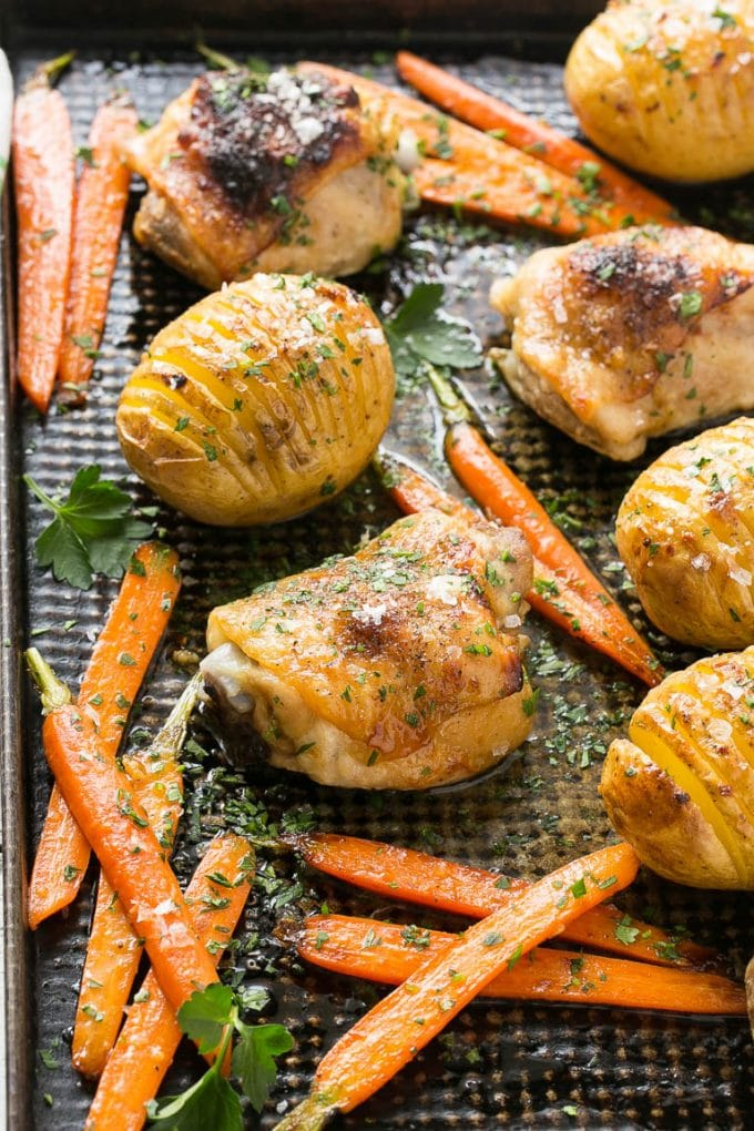 This recipe for maple dijon chicken with hasselback potatoes and carrots is a healthy and easy one pan meal that the whole family will love!