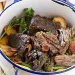 This Yankee Pot Roast is a beef roast that's been braised to meltingly tender perfection, seasoned with bacon, and served with potatoes and vegetables. A hearty and comforting meal all in one pot!