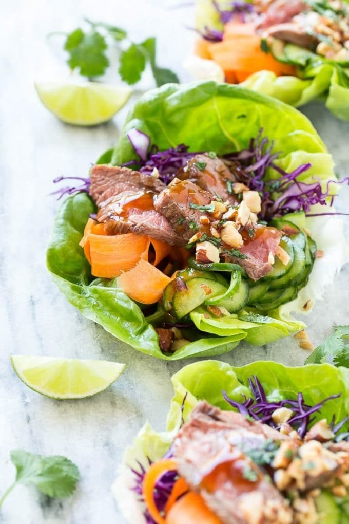 Beef lettuce wraps made with cabbage, pickled cucumbers and seared steak.