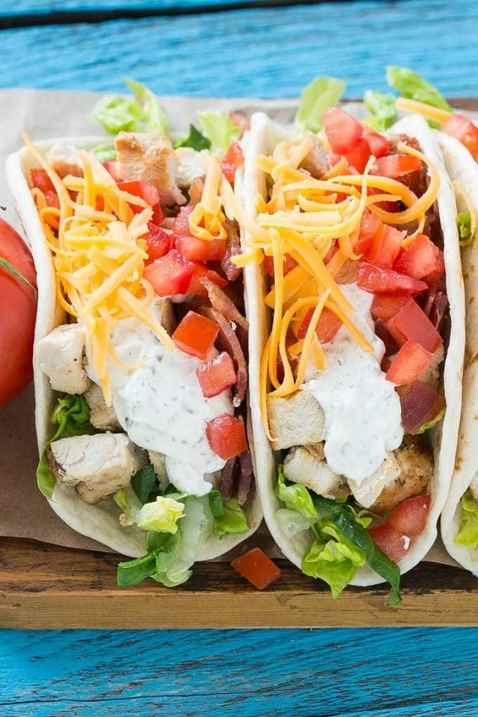 Chicken ranch tacos filled with bacon, cheese and tomatoes.