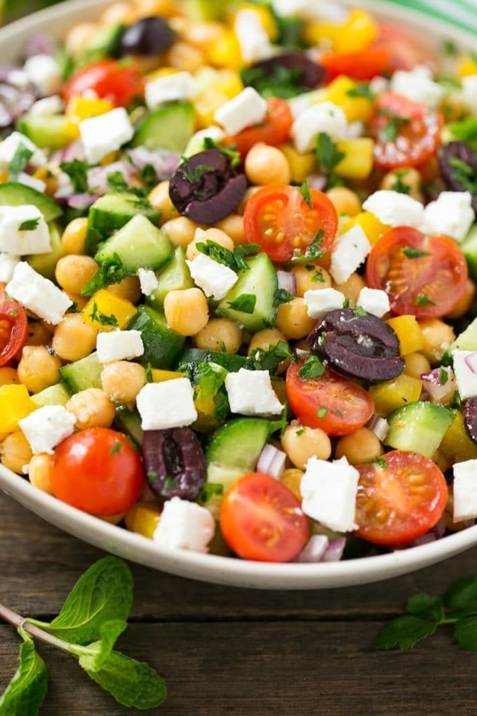 A bowl of Greek salad made with chopped vegetables.