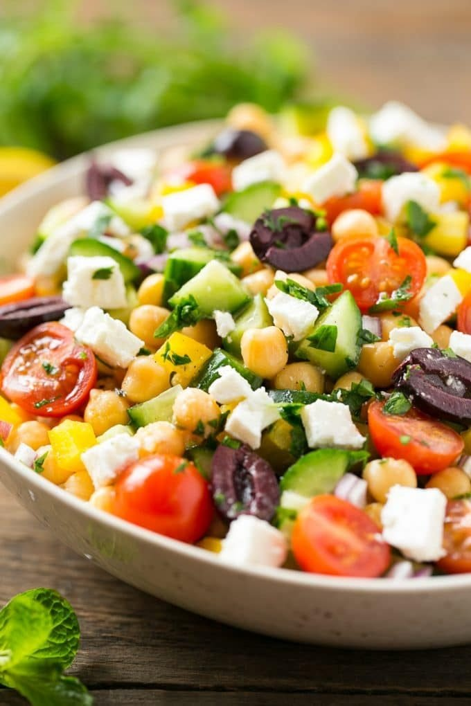Chopped Greek Salad with tomatoes, olives, cucumbers, chickpeas and feta cheese.