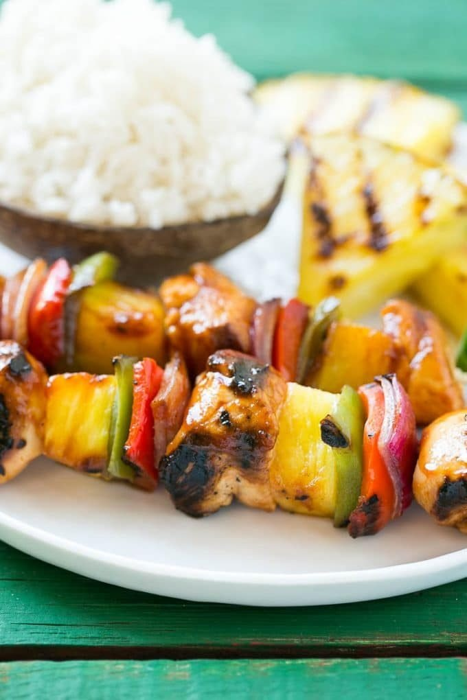 Hawaiian chicken kabobs served with coconut rice.