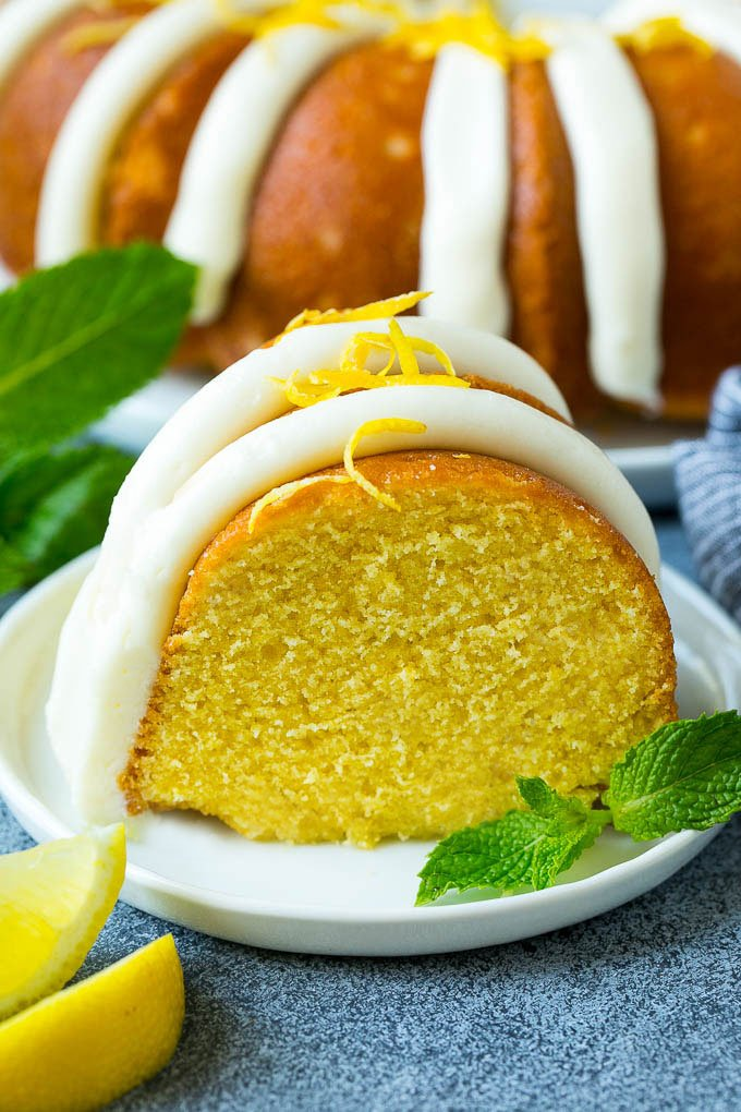A slice of lemon bundt cake topped with frosting.