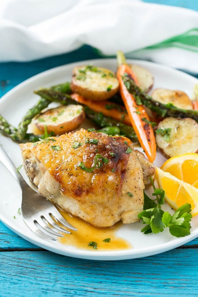 A plate with lemon thyme chicken, vegetables and potatoes.