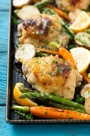 This recipe for lemon thyme chicken is a one pan meal of tender chicken thighs, new potatoes and spring vegetables, all seasoned with a sweet and savory butter and roasted to perfection. #CHHoneyGranules #ad