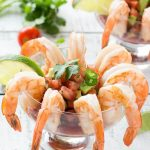 This recipe for mexican shrimp cocktail (coctel de camarones) is fresh shrimp served with a zesty cocktail sauce and a refreshing tomato avocado relish. It's an easy and elegant appetizer or light lunch!