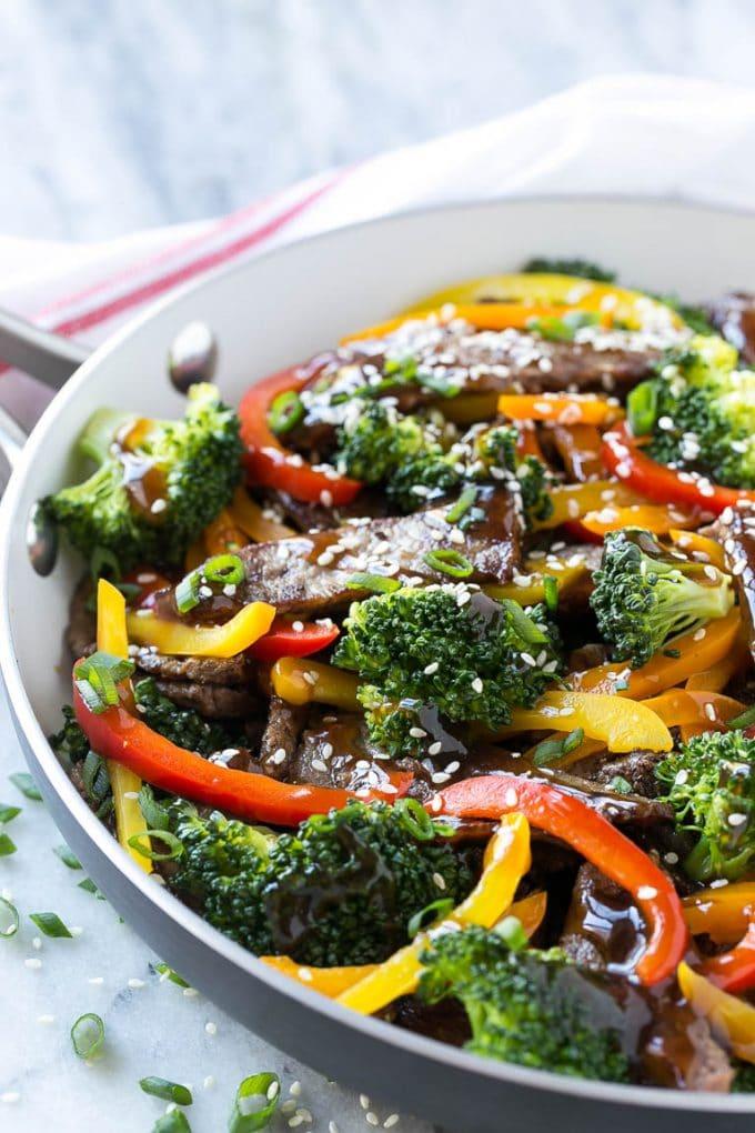 Teriyaki beef stir fry with sliced beef, homemade sauce, vegetables and sesame seeds.