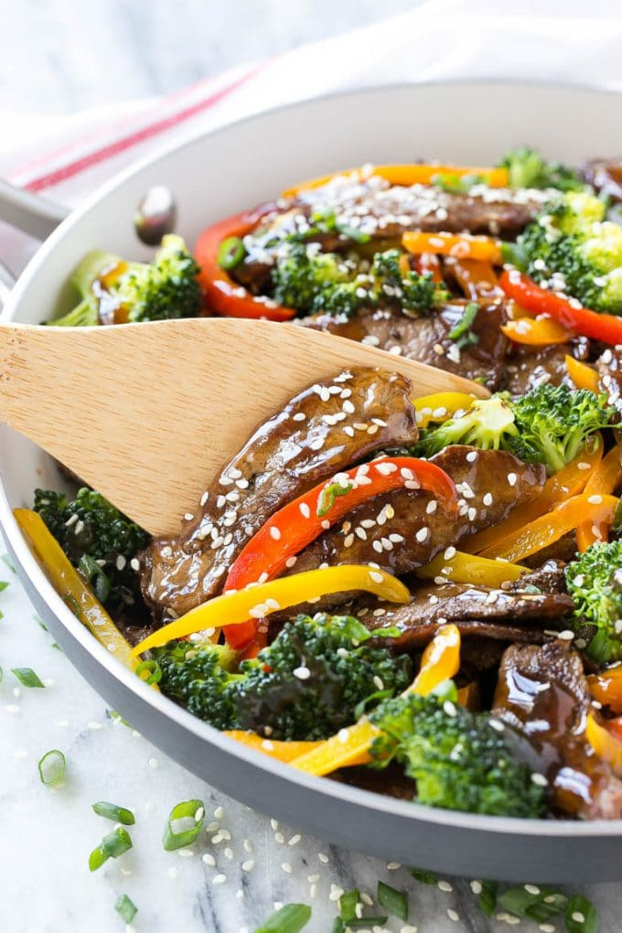 Teriyaki beef stir fry with peppers and broccoli in a skillet.