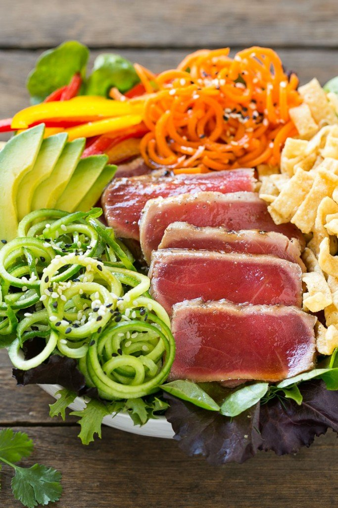 Ahi tuna salad with cucumbers, carrots and wonton strips in a sesame dressing.