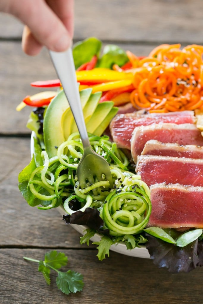 Seared ahi tuna salad over a bed of greens with bell peppers, wonton strips and cucumber.