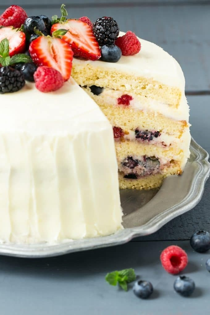 This recipe for berry chantilly cake is a light and tender yellow cake with plenty of fresh berries and a fluffy melt-in-your-mouth frosting. The perfect cake for a celebration!