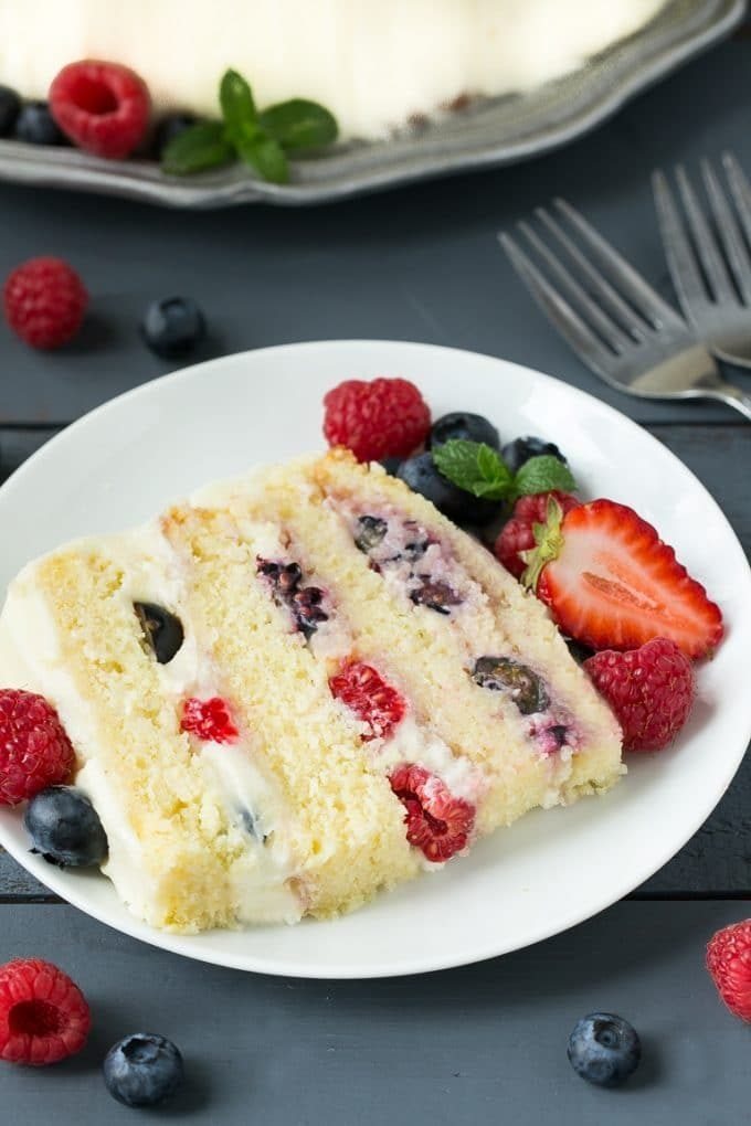 This recipe for berry chantilly cake is a light and tender cake with plenty of fresh berries and a unique fluffy whipped cream frosting. The perfect cake for a celebration!