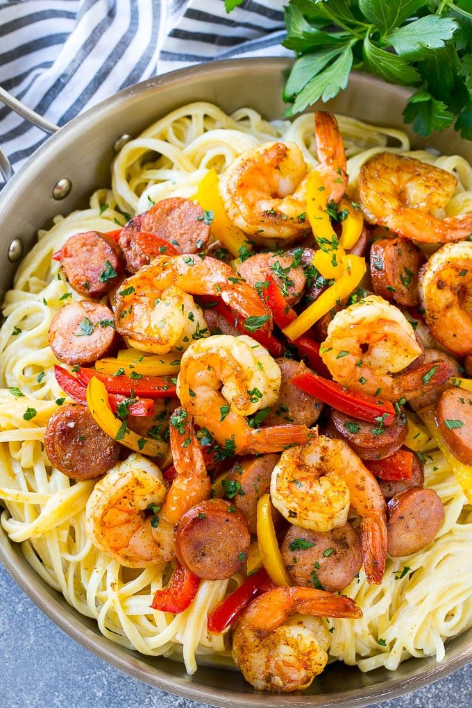 Cajun shrimp pasta is full of sausage and veggies, all served over a creamy pasta.