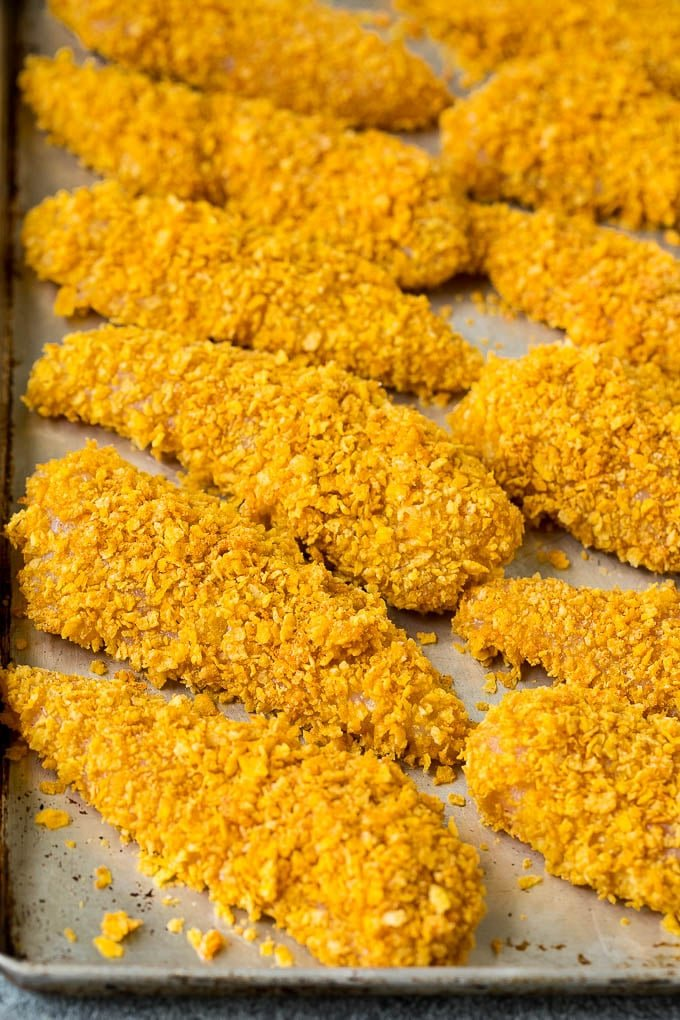 Chicken tenders rolled in crushed cornflakes.