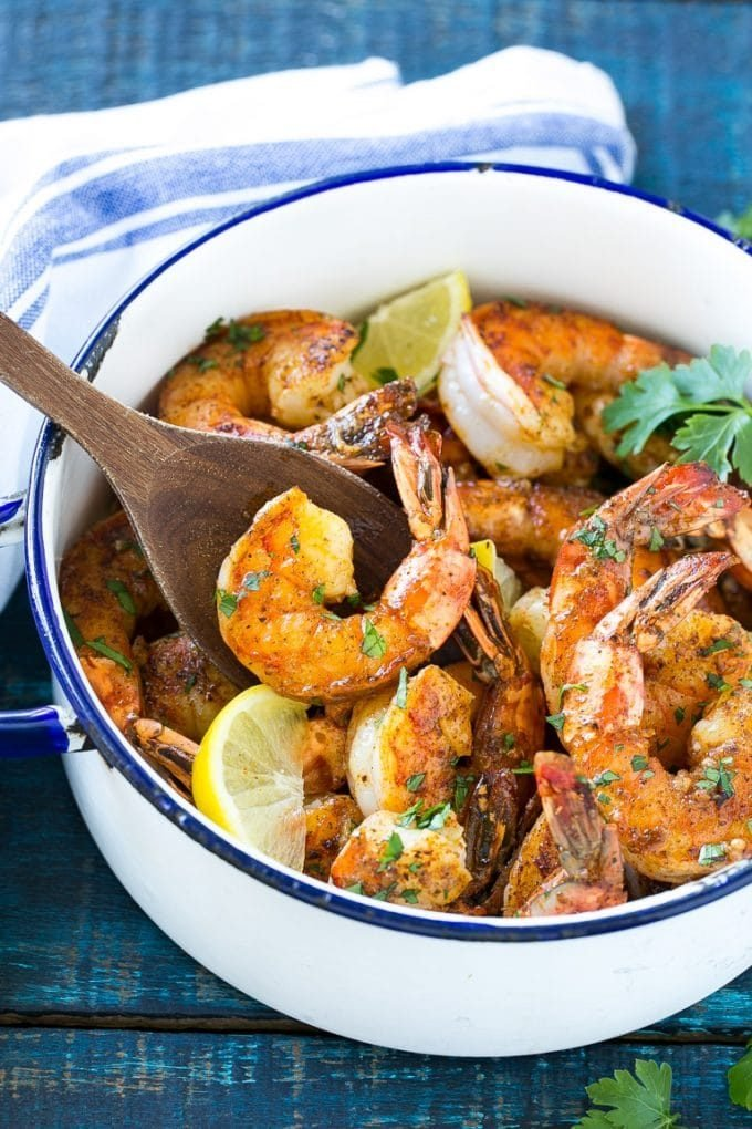 BBQ shrimp in a spiced butter sauce in a pot.