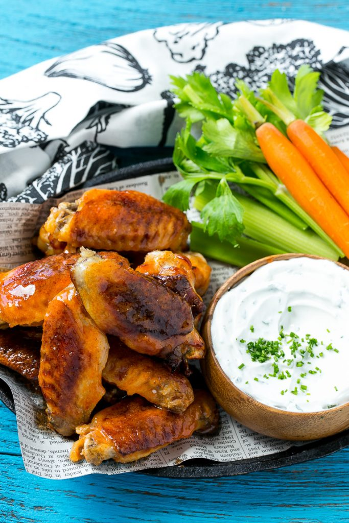 This recipe for baked buffalo wings is ultra crispy baked chicken wings tossed in a classic spicy sauce and served with a lightened up blue cheese dip. Snack away with less guilt!