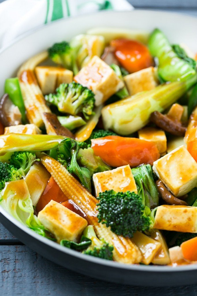 Buddha's delight with broccoli, carrots, tofu and bok choy in a frying pan.