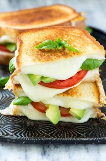 This caprese sandwich recipe is the classic combination of tomatoes, mozzarella and basil with the welcome addition of avocado slices, all sandwiched together between slices of buttery toasted bread. ArtesanoBread AD
