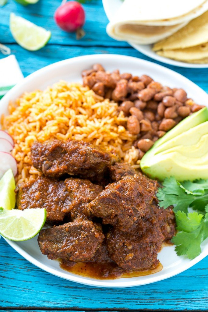 This recipe for chile colorado is a traditional Mexican dish made with tender beef that's been slow cooked in a flavorful tomato sauce. It's the perfect filling for burritos, enchiladas and tacos! #YesYouCAN ad