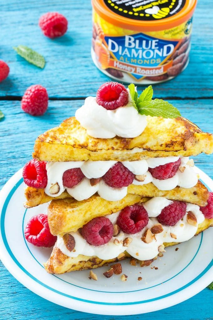 French toast filled with cream cheese and raspberries, then topped with maple syrup.