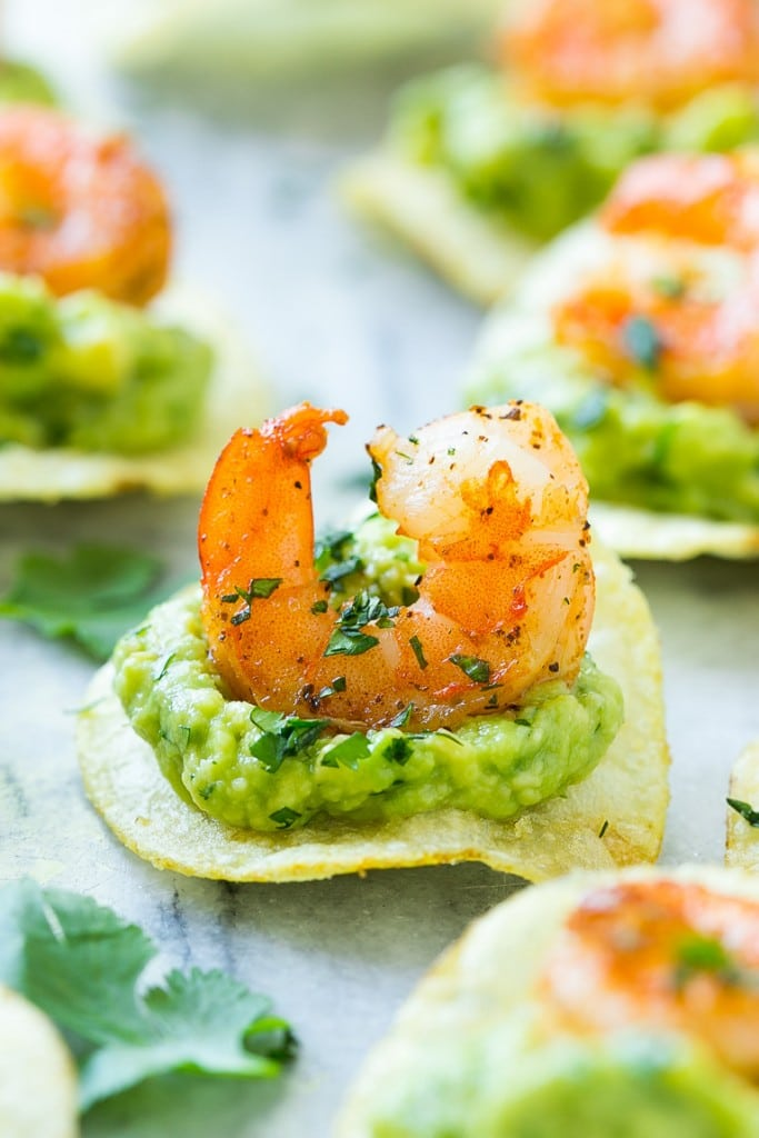 Mexican shrimp bites made with guacamole, spiced shrimp and potato chips.