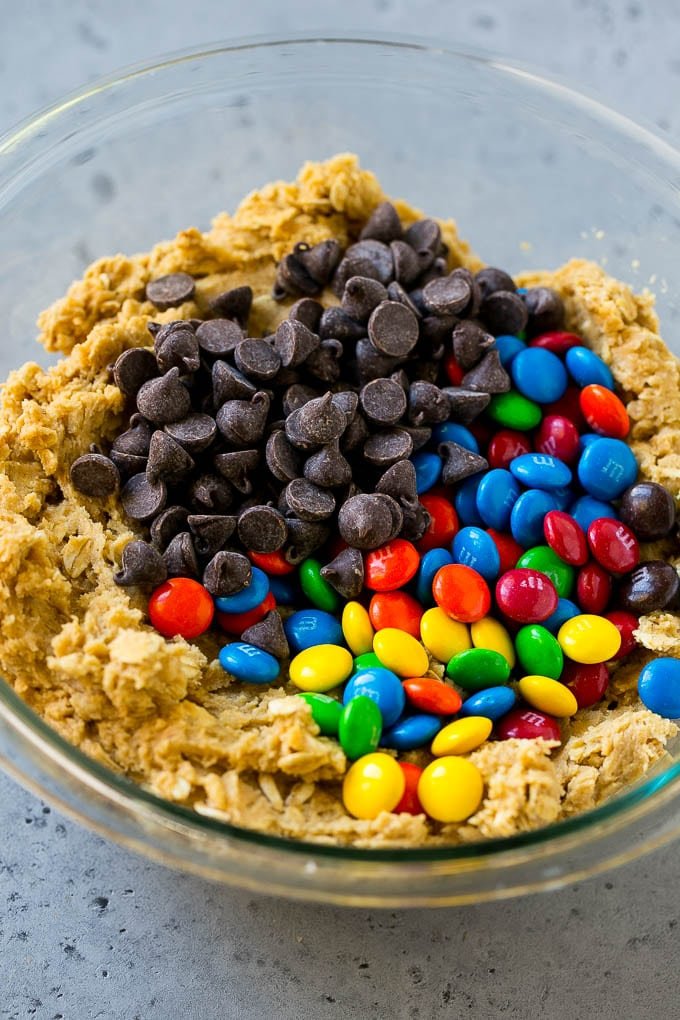 Cookie dough with chocolate chips and M&M's on top.