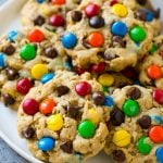 A plate of monster cookies which are made with oats, peanut butter, chocolate chips and M&M's.