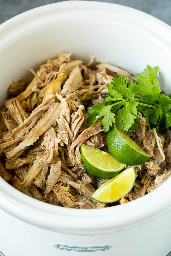 Shredded pork in a crock pot.