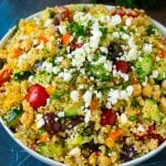 Quinoa salad with tomatoes, cucumbers, peppers, onions and olives.