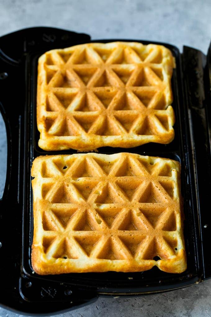 Waffles inside of a waffle iron.