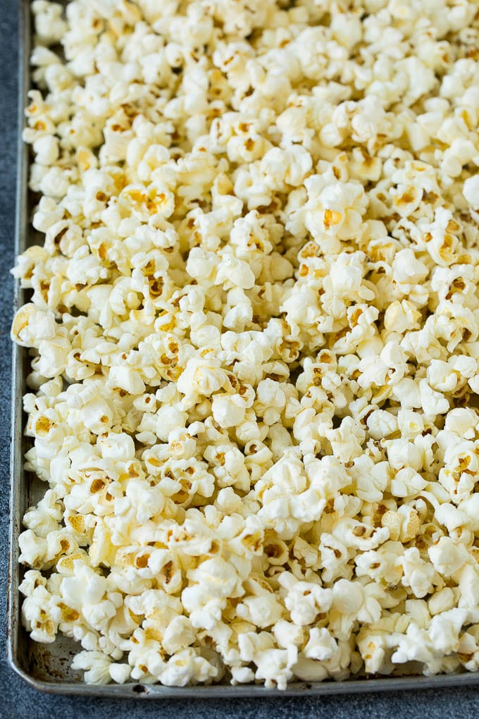 A sheet pan filled with popcorn