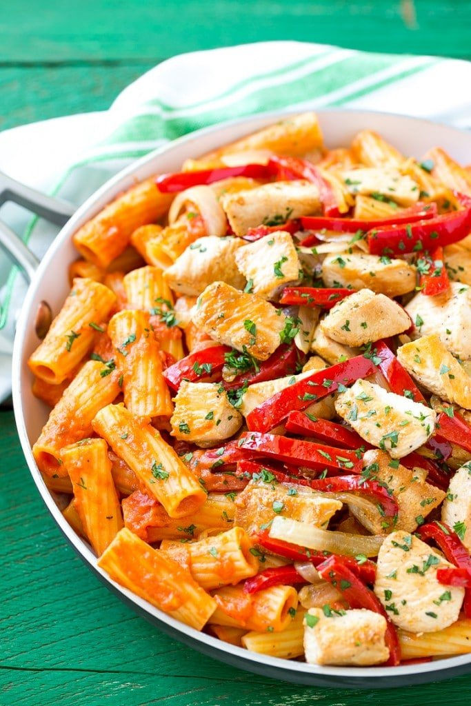 This recipe for chicken riggies is sauteed chicken with peppers and rigatoni pasta, all tossed in a creamy tomato sauce. This spicy chicken rigatoni dish is pure comfort food and can easily be doubled to serve a crowd! #ad