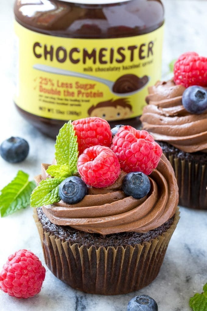 Nutella cupcakes with creamy frosting, raspberries and blueberries.