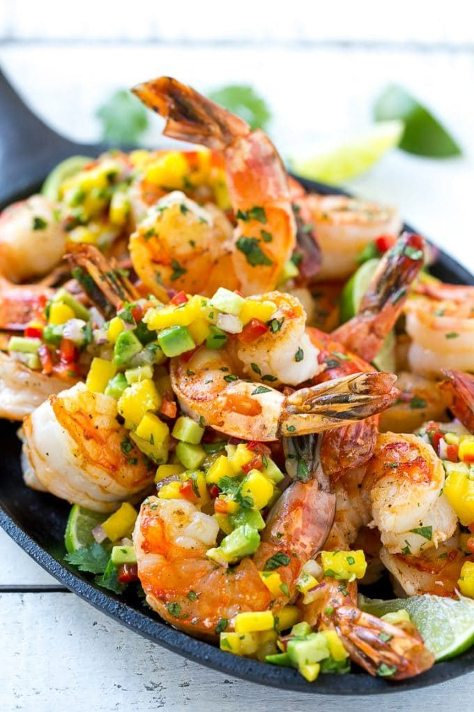 Cooked cilantro and lime flavored shrimp with a fruit salsa topping.