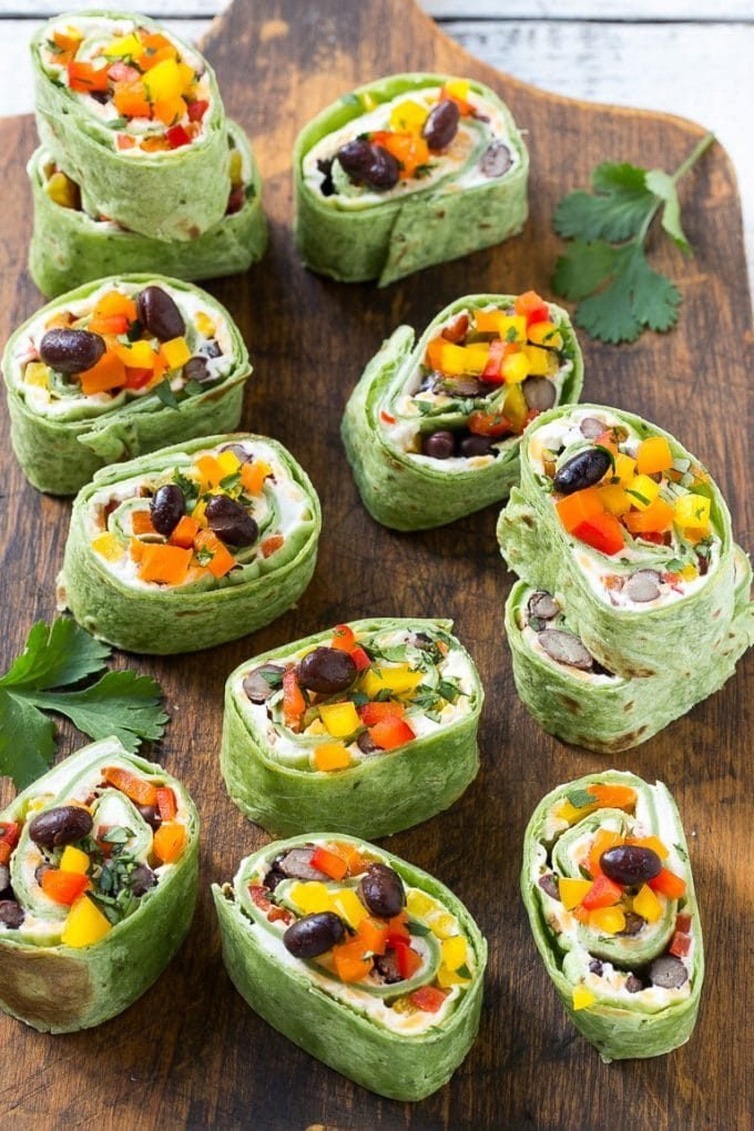 Tortilla pinwheels with a filling of cream cheese, black beans, bell peppers and seasonings.