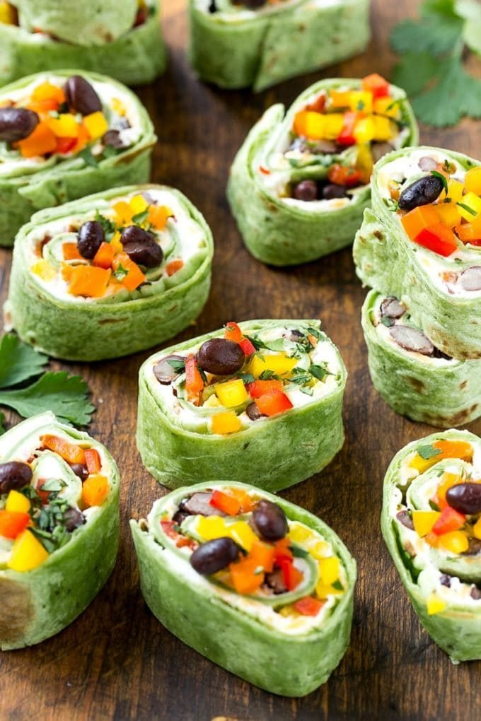 Mexican tortilla pinwheels with cheese, beans, bell peppers and cilantro.