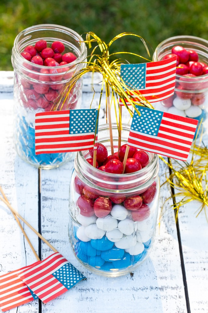 Centerpieces made with layers of red white and blue candy.