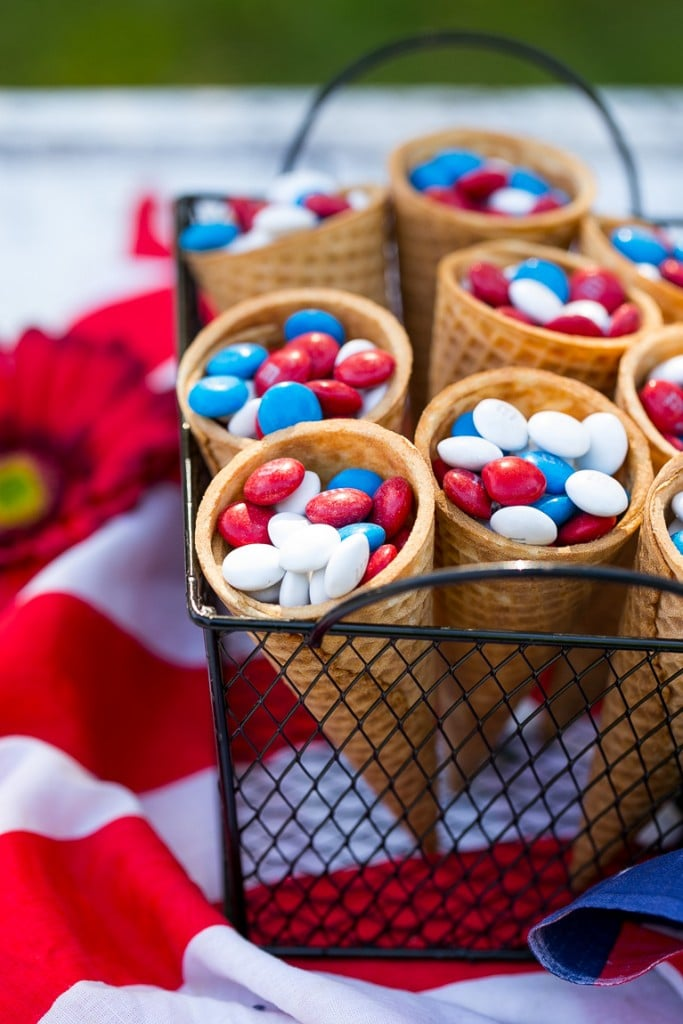 Ice cream cones filled with red white & blue M&M's.