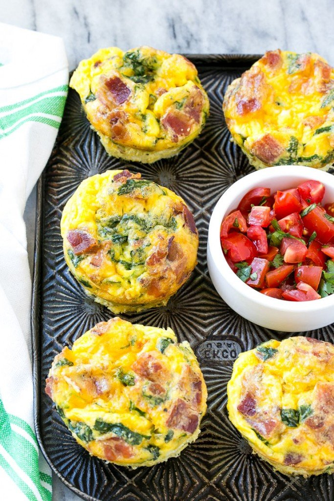 This recipe for breakfast egg muffins is an easy grab and go option for busy mornings. The protein packed egg muffins are loaded with bacon, cheddar cheese and spinach for maximum flavor! #ConquerTheExpected #ad