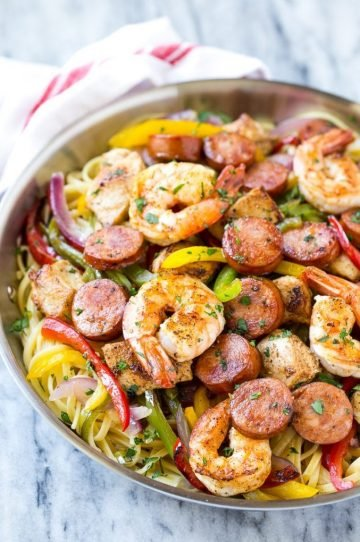 This recipe for Cajun jambalaya pasta is full of andouille sausage, shrimp, Cajun spiced chicken and vegetables, all served over creamy pasta. A hearty meal that's perfect for an everyday dinner or for entertaining! #savoryoursummerrecipes #ad