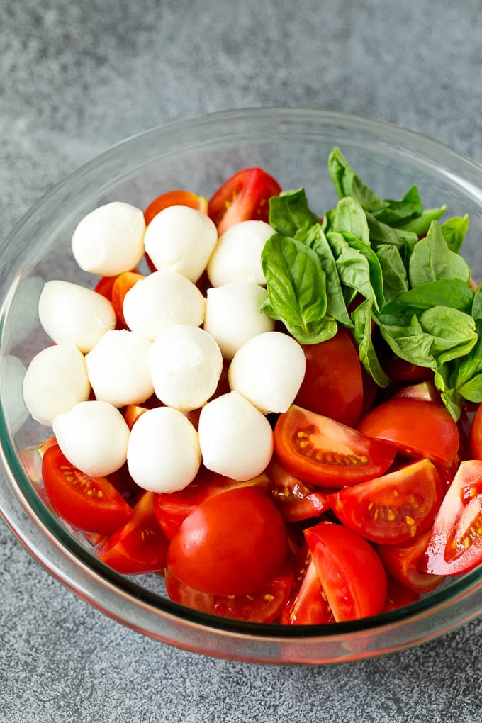 Tomatoes, mozzarella and basil in a bowl.