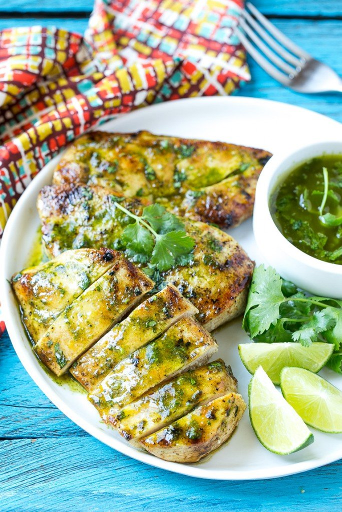 This recipe for cilantro lime chicken is marinated grilled chicken that's topped with a zesty cilantro lime sauce. The perfect quick and easy way to spice up your grilled chicken! #ConquerTheExpected #ad