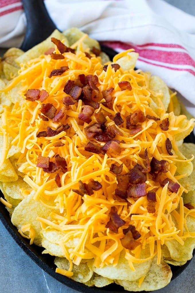 Kettle chips topped with shredded cheese and bacon.