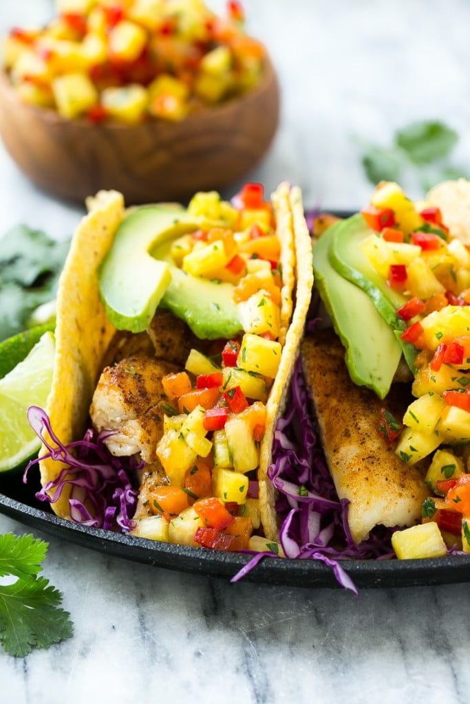 This recipe for tilapia fish tacos is seasoned fish layered with ...