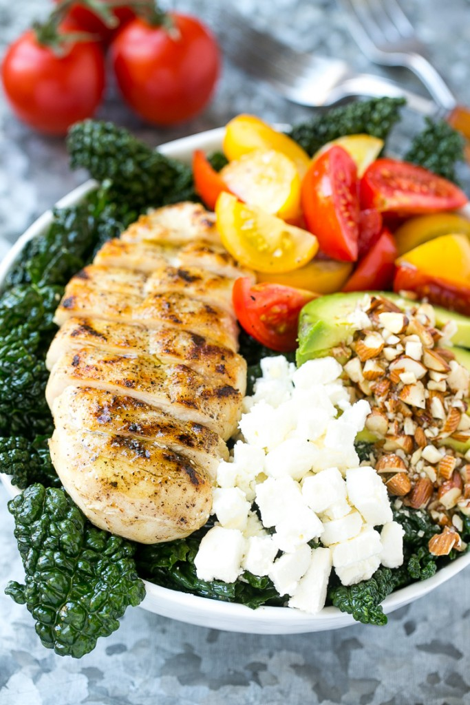 This recipe for Tuscan kale salad is full of kale, grilled chicken, avocado, tomatoes, almonds and feta cheese, all tossed in a simple lemon dressing. An easy and healthy meal! #LaneToGreatness #ad