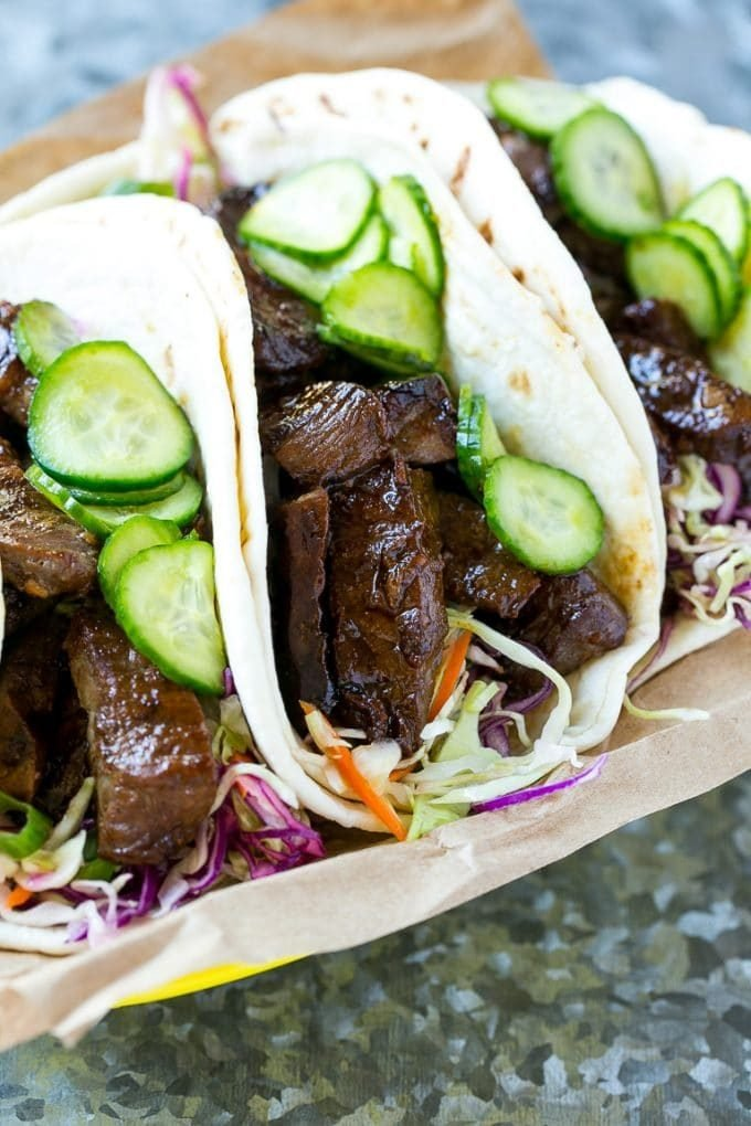 Korean BBQ tacos with cabbage and pickled cucumbers.