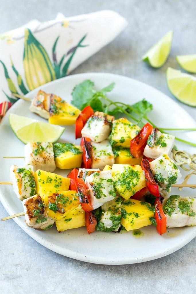 Fish kabobs with green mojo sauce.