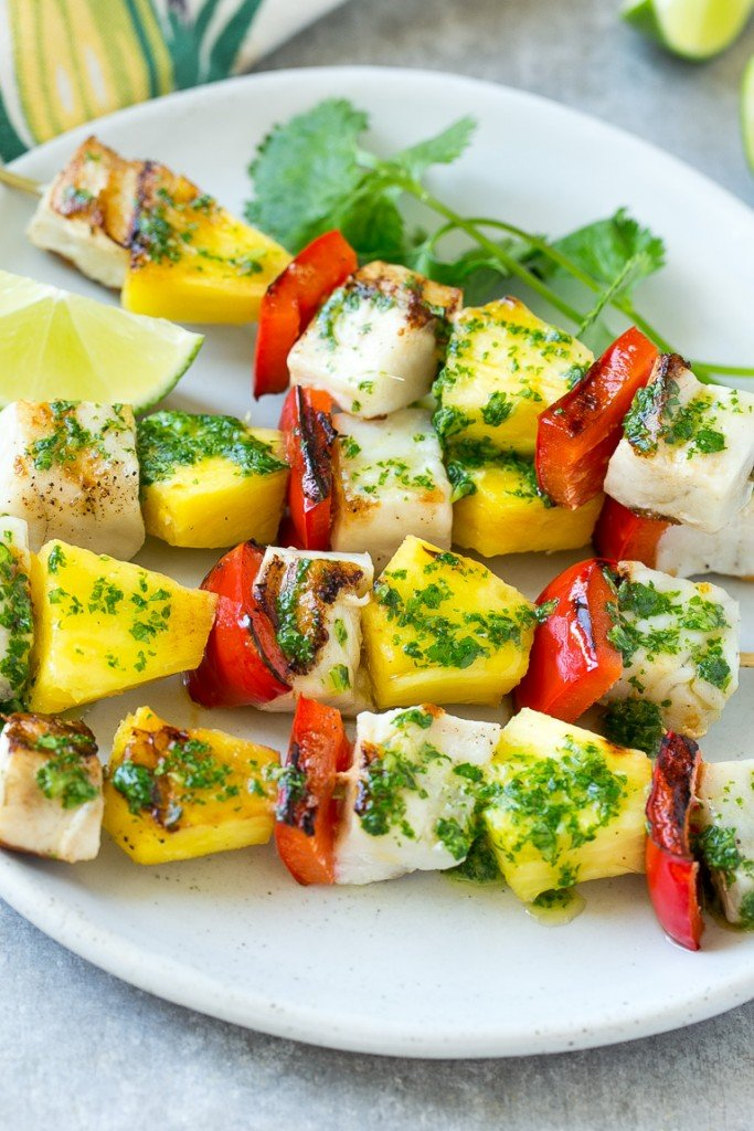 Grilled fish, peppers and pineapple on skewers.