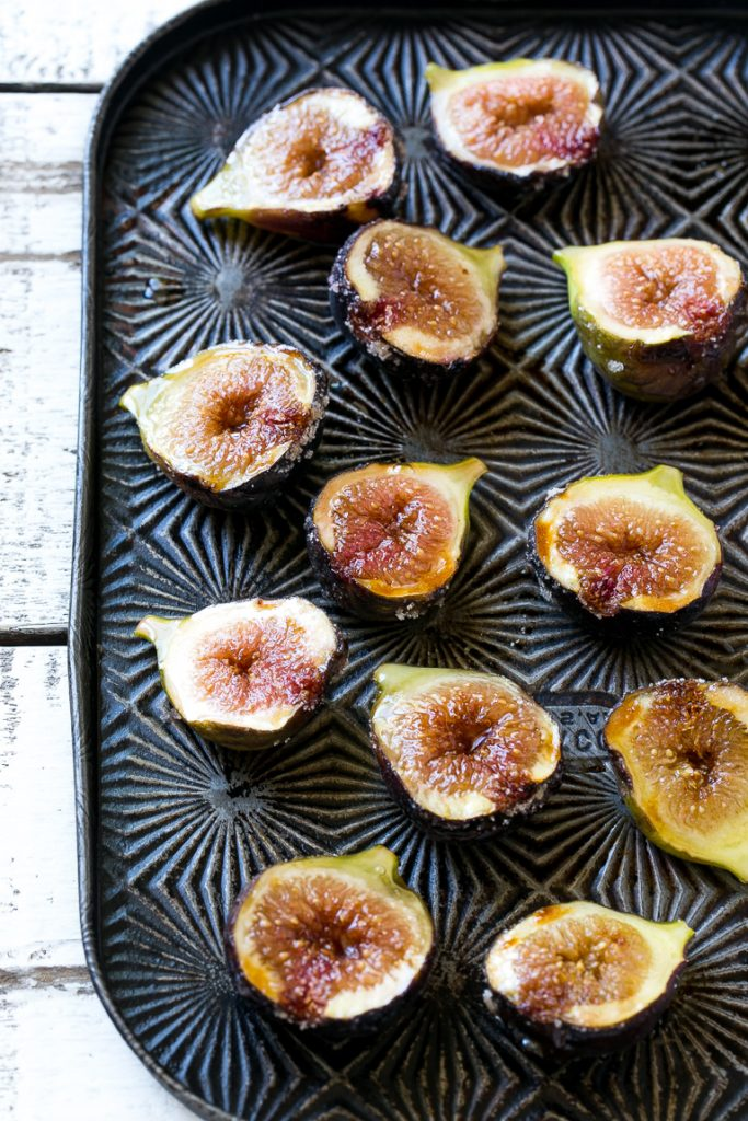 This recipe for spice roasted figs with hazelnuts and vanilla ice cream is a cool and refreshing treat that showcases fresh figs. It's an easy dessert that the whole family will love! #Breyers150 #ad